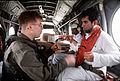 Cpl. Greg Grippo, Marine Medium Helicopter Squadron 265 (HMM-265), speaks with Dr DF-ST-92-06115.jpg