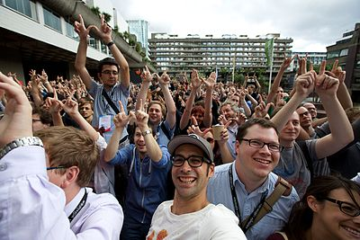 Crowd gathering for a group photo at Wikimania 2014.jpg