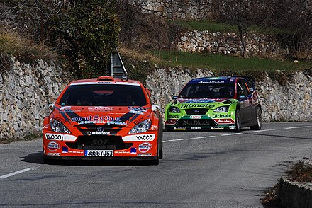 Peugeot 307 WRC and Ford Focus RS WRC 07 on a road section during the 2008 Monte Carlo Rally. Cuoq and Latvala - 2008 Monte Carlo Rally 2.jpg