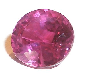 A cut ruby, with facets visible.