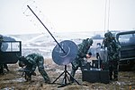 DF-ST-87-07198 US Air Force personnel set up a satellite communications antenna during Exercise REFORGER '86.jpeg