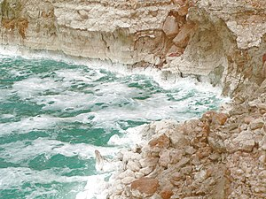 The Dead Sea on a rough day, with salt deposit...