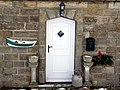 Doorway with coble fishing boat planter, Boulby - geograph.org.uk - 1626166.jpg