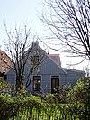 foto van Houten huis met puntvormig voorschot