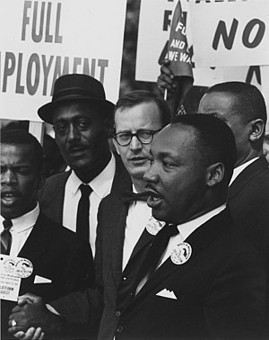 Peace - Martin Luther King, Jr., president of the Southern Christian Leadership Conference, and Mathew Ahmann, executive director of the National Catholic Conference for Interrracial Justice, at a civil rights march on Washington, D.C.