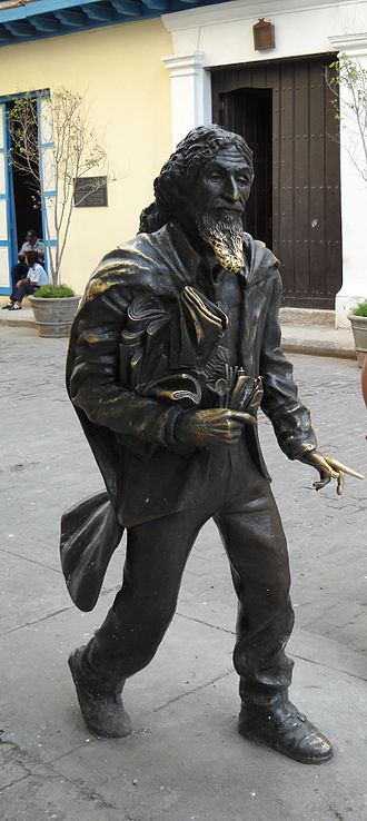 "Street people - Bronze statue of José María López Lledín known as ""El Caballero de Paris"" in Havana, Cuba, by sculptor Jose Villa Soberon. Unlike the nearby statue of St. Francis, this statue stands simply on the sidewalk and is a popular tourist attraction. The statue's beard has been polished by the hands of people standing to be photographed with it, for luck."
