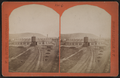 Erie Railroad yard, including view of a round house and watertower, by W. L. Sutton.png