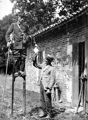 Stilts - French postman on stilts, early 20th Century