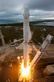 Falcon 9 and Dragon lift off from Launch Pad 39A for CRS-10 (32852845662).jpg