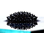 Ferrofluid under the influence of a strong vertical magnetic field.
