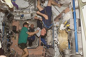 Effect of spaceflight on the human body - Astronauts on the ISS in weightless conditions. Michael Foale can be seen exercising in the foreground.