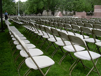Folding chair - Folding chairs of the side-X variety set up for an outdoor event
