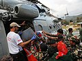 French and Polish Rescue team with Nepalese Army are boarding quake affected injured persons on an IAF Helicopters, in Melanchi, Nepal (3).jpg