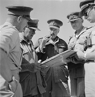 Neil Ritchie - Neil Ritchie (centre, with pipe) addressing other officers in North Africa, sometime in 1942. Also pictured are Willoughby Norrie and William Gott.