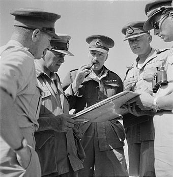 General Ritchie (holding pipe) addressing his commanders, 31 May 1942. Norrie holding map, Gott to right of Ritchie. GenRitchie.jpg