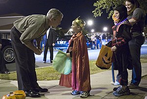George W Bush with trick-or-treaters, Robins Air Force Base, Georgia - 20061031.jpg