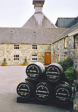 Glenfiddich - Wooden barrels stacked outside the main reception.