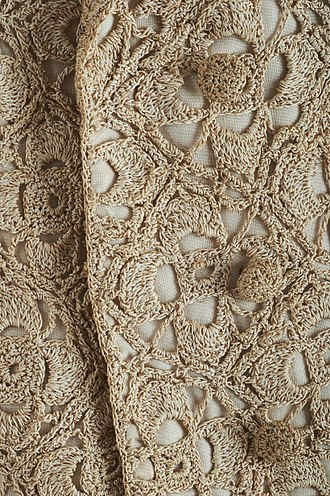 Crochet - Detail on gold thread crochet in a mid-20th century short jacket designed by Sybil Connolly