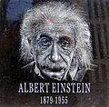 Hand etched portrait over black granite of Albert Einstein.jpg