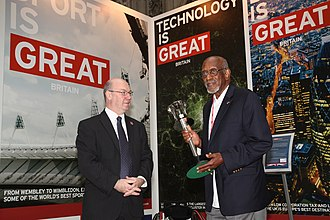 Harrison Dillard - Foreign Office Minister Alistair Burt with Harrison Dillard holding the 1948 London Olympics torch, August 1, 2012.