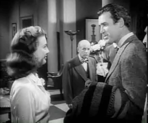 Harvey (film) - Miss Kelly (Peggy Dow) and Dowd (James Stewart). Judge Gaffney (William H. Lynn) is in the background.