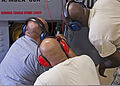 Henry Castro, left, U.S. Air Force Senior Airman Mychal Hamilton and Staff Sgt. Christopher Goff, all with the 361st Training Squadron, check a gas turbine generator's wiring to troubleshoot an electrical 110608-F-NS900-017.jpg