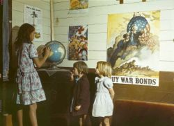 Rural school children in front of homefront posters. San Augustine County, Texas. 1943.