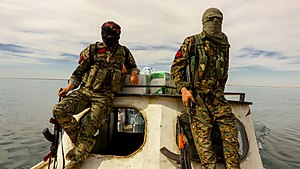 Raqqa campaign (2016–2017) - IRPGF fighters crossing Lake Assad by boat