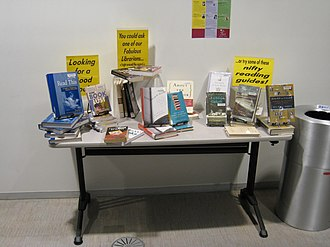 "Readers' advisory - Indirect readers' advisory display: ""Looking for a good book? . . . You could ask one of our Fabulous Librarians . . . or try some of these nifty reading guides"""