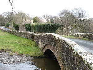 Grade I listed buildings in Cumbria - Image: Isel Hall, and the bridge over Blumer Beck (geograph 3380818)