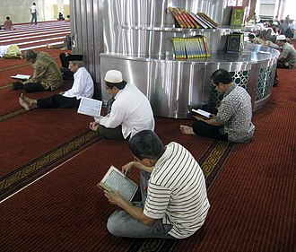Islam in Indonesia - Indonesian Muslims reading the Quran in Masjid Istiqlal, Jakarta, Indonesia