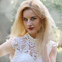 Ivana van der Veen posing during a photo shoot for her Angel video.jpg