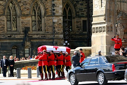 Layton's coffin is taken from Parliament Hill after lying in state in Ottawa. Jack Layton leaves parliament.jpg