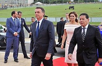 Brazilian presidential inauguration - Mr. President Jair Bolsonaro climbing the ramp of the National Congress with his wife, Michelle Bolsonaro, and the vice president, Hamilton Mourão, on January 1, 2019.