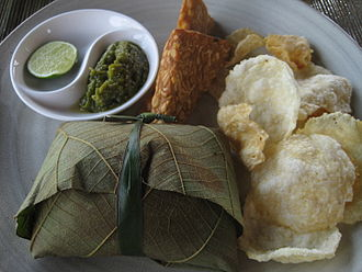 Javanese people - Example of Javanese cuisine. Clockwise: fried tempeh, mlinjo crackers, gudeg with rice wrapped in teak leaf, green chili sambal and sliced lime.