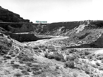 Fluvial terrace -  Eroded alluvial fill 60 feet (18 m) thick at Kanab Creek, Kane County, Utah. In 1884 the stream ran at top of the terrace. 1939 photo by United States Geological Survey.