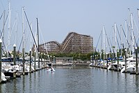 The boardwalk rollercoaster appears in the background with the lake and the marina in the foreground