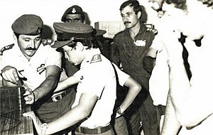 Abdullah (age 11) in uniform with soldiers