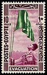 King Farouk rising Egyptian flag marking starting Evacuation of the British occupation 1946.jpg