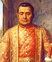 A portrait of a man wearing ornate robes