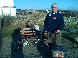 "Land's End to John o' Groats - Richard Elloway, having completed the return trip using a senior bus-pass ""without paying a penny""."