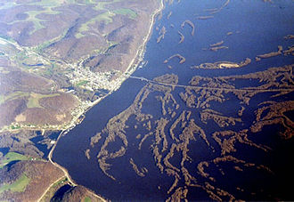 Lansing, Iowa - Aerial view looking north, April 14, 2001, with Mississippi River at floodstage; the Black Hawk Bridge is visible; Big Lake is immediately north