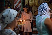 Lighting candles in cerkva.jpg