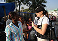 Liz Detmeister, a spokesperson for the Haiti Joint Information Center, speaks with a Haitian woman 100131-N-HX866-001.jpg