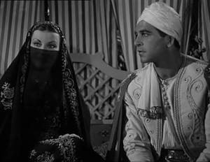 Enzo Fiermonte - Silvana Pampanini and Fiermonte in a scene from the 1950 film Hawk of the Nile