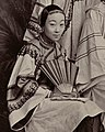 Lower left woman detail, from- Courtesans in Shanghai by Afong c1875-80 (cropped).jpg