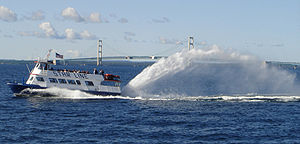 A Mackinac Island ferry passing in front of th...