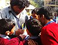 Magician krishna bhandari signing autograph for kids after magic show.JPG