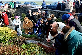 Imbolc - People making Brigid's crosses at St Brigid's Well near Liscannor