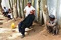 Man being shaved with straight razor. Roadside, Kashgar.jpg